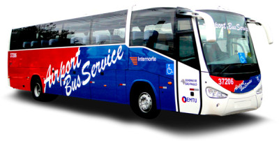 "Image of the left side of the bus. It has on the top 5 large windows, from the front to the rear. The bottom is all painted, the front half dark blue and the back half red. In the center, it is written diagonally with large white letters ""Airport Bus Service""."