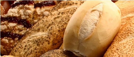Image in close up. Various types and sizes of breads.