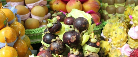 Image in close up. Several exotic and multicolored fruits.